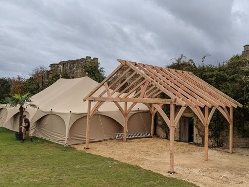 Large tent frame being erected for wedding reception